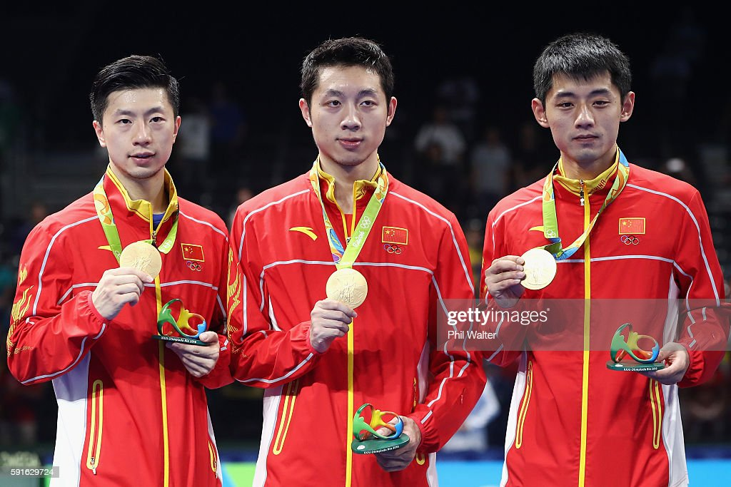 Gold medalists Long Ma, Xin Xu, and Jike Zhang of China celebrate during the medals ceremony after the Men's Table Tennis gold medal match against Japan at Riocentro - Pavilion 3 on Day 12 of the Rio 2016 Olympic Games on August 17, 2016 in Rio de Janeiro, Brazil.