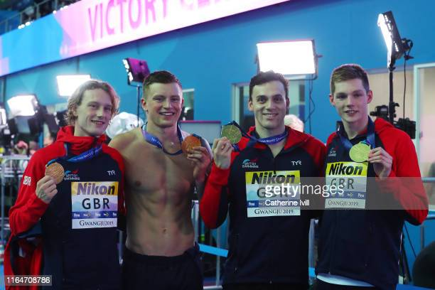 Gold medalists Luke Greenbank Adam Peaty James Guy and Duncan Scott of Great Britain pose after the medal ceremony for the Men's 4x100m Medley Relay...