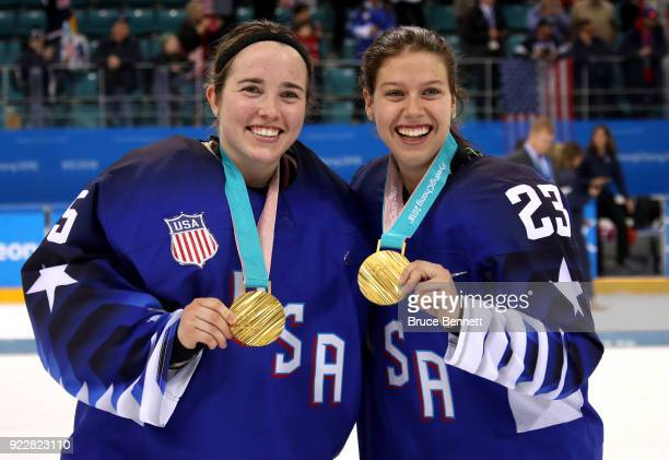 Gold medalists Madeline Rooney and Sidney Morin of the United States pose after defeating Canada 32 in the overtime penaltyshot shootout during the...
