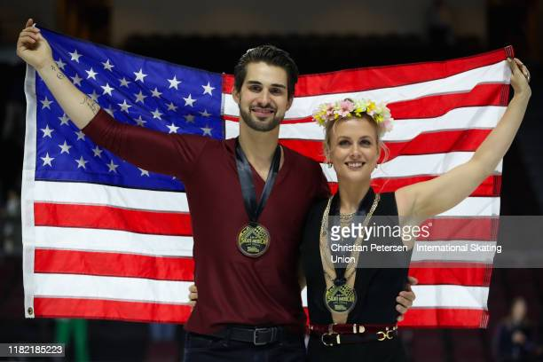 Gold medalists Madison Hubbell and Zachary Donohue of the United States pose together after winning the ice dance competition the ISU Grand Prix of...