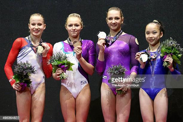 Gold medalists Madison Kocian of the United States Daria Spiridonova of Russia Viktoriia Komova of Russia and Fan Yilin of China pose on the podium...