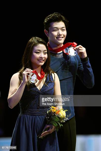 Gold medalists Maia Shibutani and Alex Shibutani pose on the podium at the medal ceremony for the Ice Dance during the day three of the 2016...
