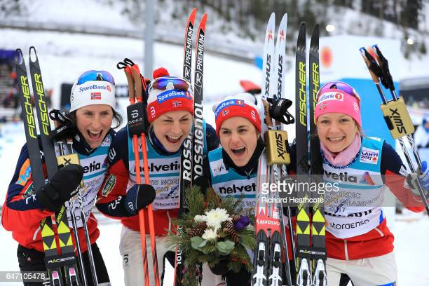 Gold medalists Maiken Caspersen Falla, Heidi Weng, Astrid Uhrenholdt Jacobsen and Marit Bjoergen of Norway celebrate during the flower ceremony for...