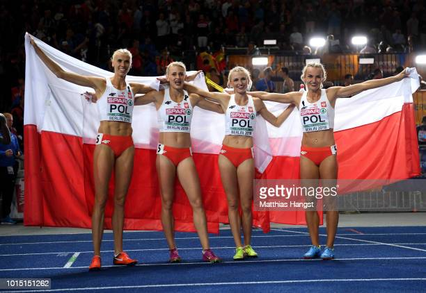 Gold medalists Malgorzata HolubKowalik Iga BaumgartWitan Patrycja Wyciszkiewicz and Justyna SwietyErsetic of Poland celebrate after the Women's 4 x...
