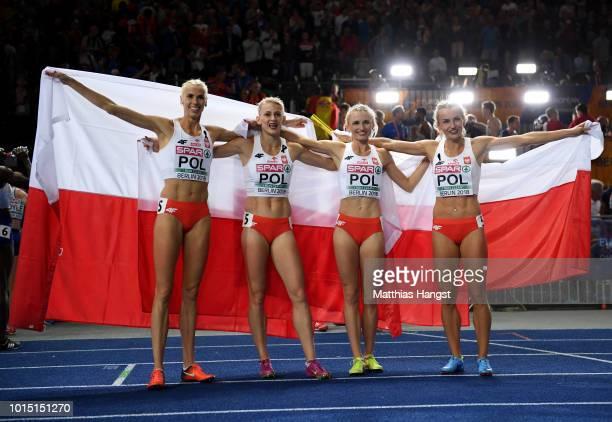 Gold medalists Malgorzata HolubKowalik Iga BaumgartWitan Patrycja Wyciszkiewicz and Justyna SwietyErsetic of Poland celebrate after the Women's 4 x...