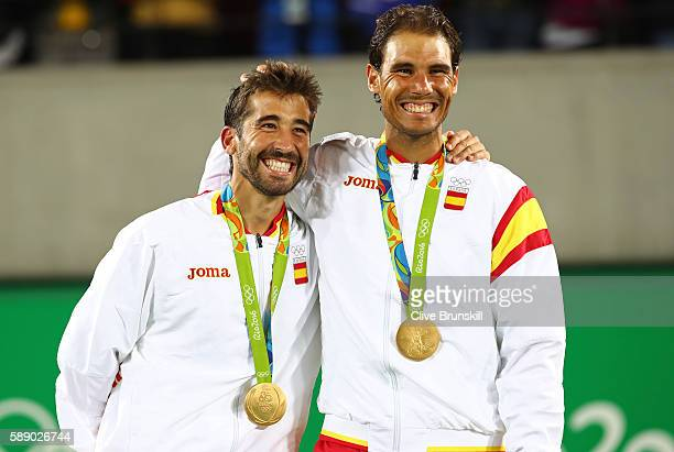 Gold medalists Marc Lopez and Rafael Nadal of Spain stand on the podium after the Men's Doubles competition on Day 7 of the Rio 2016 Olympic Games at...