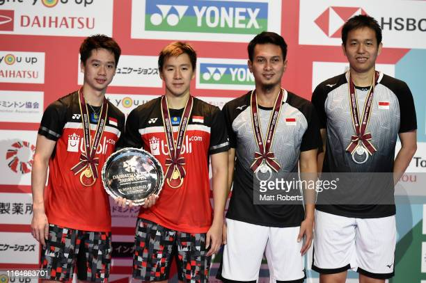 Gold medalists Marcus Fernaldi Gideon and Kevin Sanjaya Sukamuljo of Indonesia and silver medalists Mohammad Ahsan and Hendra Setiawan of Indonesia...