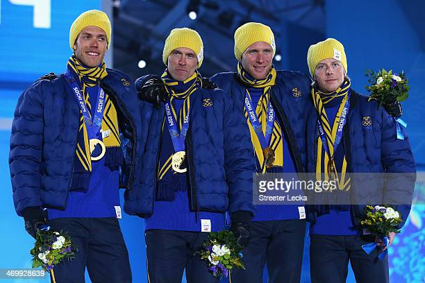 Gold medalists Marcus Hellner, Johan Olsson, Daniel Richardsson and Lars Nelson of Sweden celebrate on the podium during the medal ceremony for the...