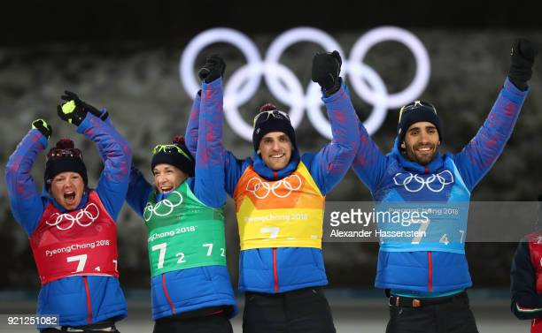 Gold medalists Marie Dorin Habert Anais Bescond Simon Desthieux and Martin Fourcade of France celebrate during the victory ceremony after the...