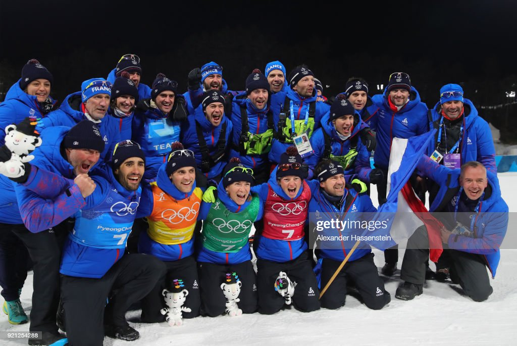 Gold medalists Marie Dorin Habert, Anais Bescond, Simon Desthieux and Martin Fourcade of France celebrate with their team after the victory ceremony for the Biathlon 2x6km Women + 2x7.5km Men Mixed Relay on day 11 of the PyeongChang 2018 Winter Olympic Games at Alpensia Biathlon Centre on February 20, 2018 in Pyeongchang-gun, South Korea.
