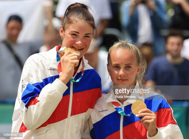 Gold Medalists Mariia Bocharova and Maria Voronina of Russia pose in the podium of Women's Volleyball on day 11 of Buenos Aires 2018 Youth Olympic...