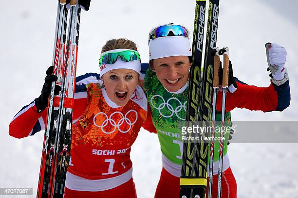 Gold medalists Marit Bjoergen of Norway and Ingvild Flugstad Oestberg of Norway celebrate after the Women's Team Sprint Classic Final during day 12...
