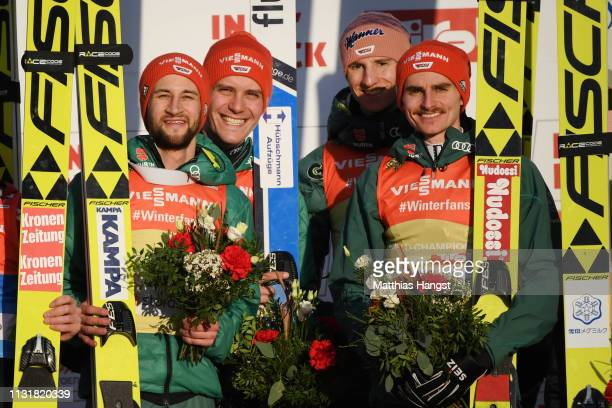 Gold medalists Markus Eisenbichler Karl Geiger Richard Freitag and Stephan Leyhe of Germany pose for a photo during the flower ceremony for the Men's...
