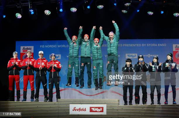 Gold medalists Markus Eisenbichler Karl Geiger Richard Freitag and Stephan Leyhe of Germany celebrate during the medal ceremony for the Men's Team...