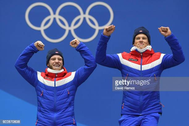 Gold medalists Martin Johnsrud Sundby and Johannes Hoesflot Klaebo of Norway celebrate during the medal ceremony for CrossCountry Skiing Men's Team...