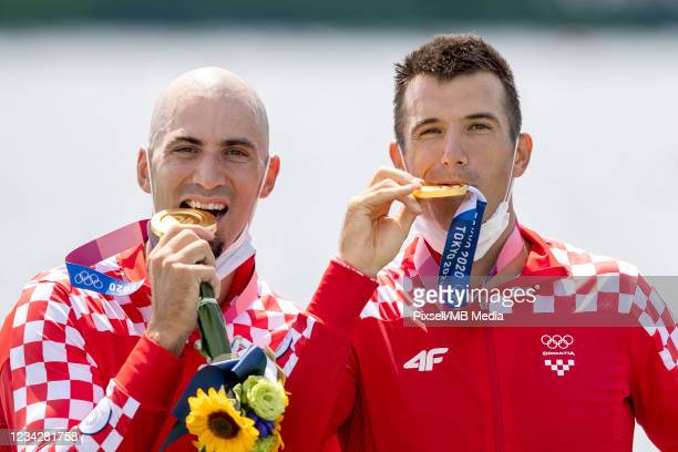 Gold medalists Martin Sinkovic and Valent Sinkovic of Team Croatia pose with their medals during the medal ceremony for the Men's Pair Final A on day...
