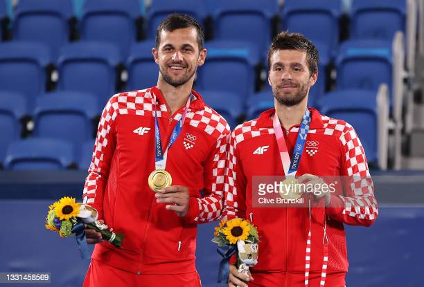 Gold medalists Mate Pavic of Team Croatia and Nikola Mektic of Team Croatia pose with their gold medals for Tennis Mens Doubles on day seven of the...