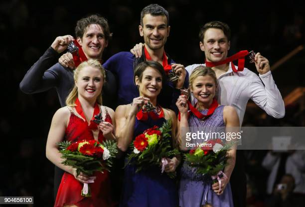 Gold medalists Meagan Duhamel and Eric Radford center pose for a picture with silver medalists Julianne Seguin and Charlie Bilodeau left and Kirsten...