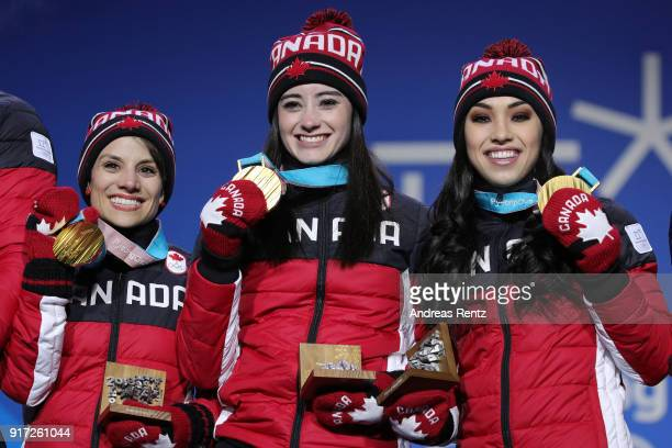 Gold medalists Meagan Duhamel Kaetlyn Osmond and Gabrielle Daleman of Team Canada celebrate during the medal ceremony after the Figure Skating Team...