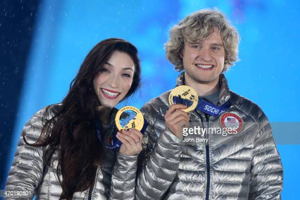 Gold medalists Meryl Davis and Charlie White of the United States celebrate during the medal ceremony for the Figure Skating Ice Dance on day 11 of...