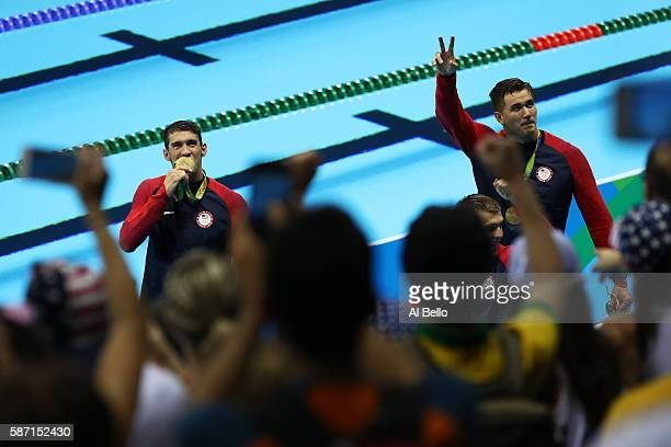 Gold medalists Michael Phelps and Nathan Adrian of the United States wave to the crowd during the medal ceremony for the Final of the Men's 4 x 100m...