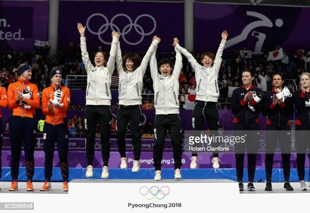 Gold medalists Miho Takagi Ayaka Kikuchi Ayano Sato and Nana Takagi of Japan celebrate during the victory ceremony after the Speed Skating Ladies'...