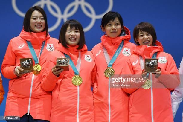 Gold medalists Miho Takagi Ayaka Kikuchi Ayano Sato and Nana Takagi of Japan celebrate during the medal ceremony for Speed Skating Ladies' Team...
