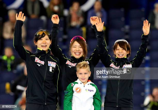 Gold medalists Miho Takagi Ayano Sato and Nana Takagi of Japan celebrate on the podium at the medal ceremony for the Women's Team Pursuit during day...