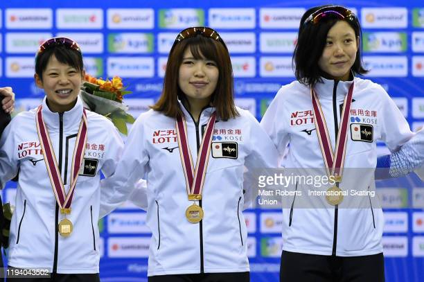 Gold medalists Miho Takagi, Nana Takagi and Ayano Sato of Japan pose during the medal ceremony of the Women's Team Pursuit Division A during the ISU...