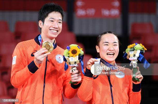 Gold medalists Mima Ito and Jun Mizutani of Team Japan pose for photographs at the medal ceremony for the Mixed Doubles on day three of the Tokyo...