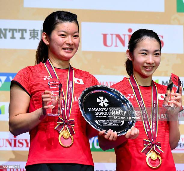 Gold medalists Misaki Matsutomo and Ayaka Takahashi of Japan celebrate on the podium at the medal ceremony for the Women's Doubles during day six of...