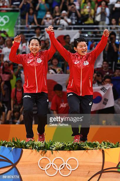 Gold medalists Misaki Matsutomo and Ayaka Takahashi of Japan pose on the podium during the medal ceremony for the Women's Doubles Badminton on Day 13...