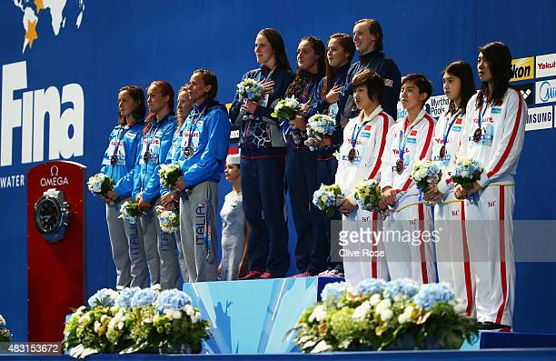 Gold medalists Missy Franklin Leah Smith Katie McLaughlin and Katie Ledecky of the United States poses with silver medalists Alice Mizzau Erica Musso...