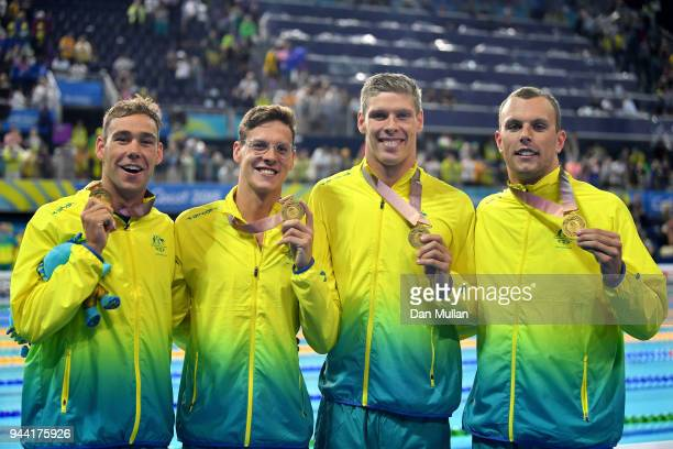Gold medalists Mitch Larkin Jake Packard Grant Irvine and Kyle Chalmers of Australia pose during the medal ceremony for the Men's 4 x 100m Medley...
