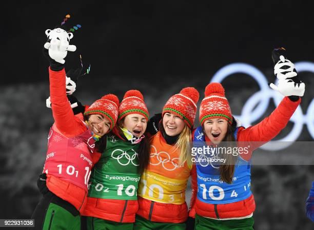 Gold medalists Nadezhda Skardino Iryna Kryuko Dzinara Alimbekava and Darya Domracheva of Belarus celebrate on the podium during the victory ceremony...