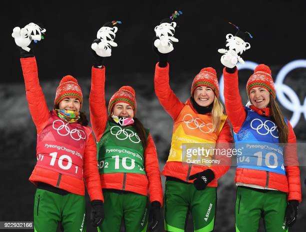 Gold medalists Nadezhda Skardino Iryna Kryuko Dzinara Alimbekava and Darya Domracheva of Belarus celebrate on the podium during the victory ceremony...