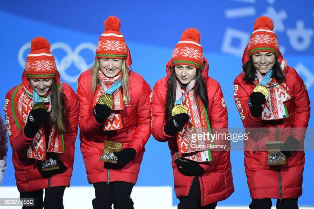 Gold medalists Nadezhda Skardino Iryna Kryuko Dzinara Alimbekava and Darya Domracheva of Belarus celebrate during the medal ceremony for Biathlon...