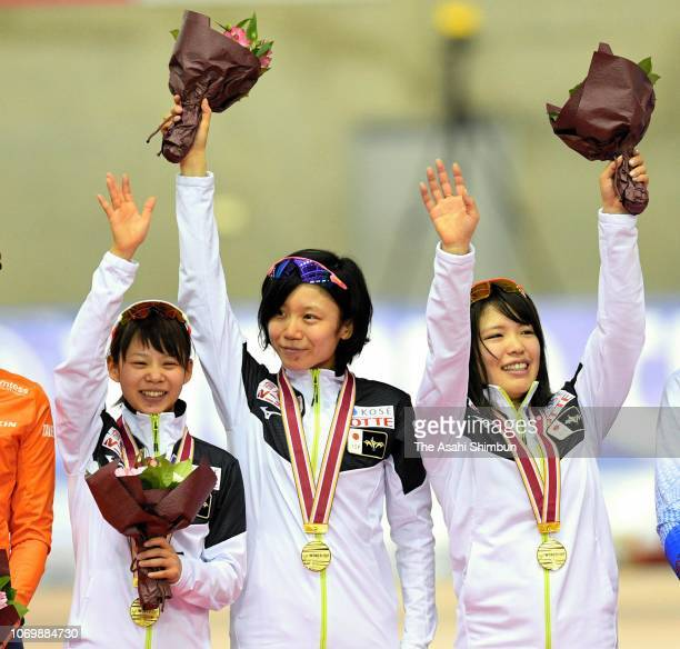 Gold medalists Nana Takagi Miho Takagi and Ayano Sato of Japan celebrate on the podium at the medal ceremony for the Women's Team Pursuit on day one...