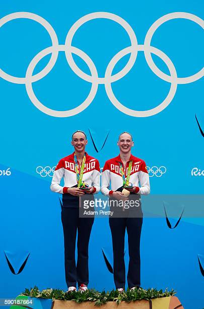 Gold medalists Natalia Ishchenko and Svetlana Romashina of Russia pose during the medal ceremony for the Synchronised Swimming Duets Free Routine...