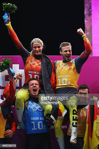 Gold medalists Natalie Geisenberger Felix Loch Tobias Arlt and Tobias Wendl of Germany celebrate during the flower ceremony for the the Luge Relay on...