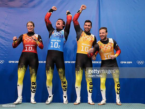 Gold medalists Natalie Geisenberger Felix Loch Tobias Wendl and Tobias Arlt of Germany celebrate during the flower ceremony for the the Luge Relay on...