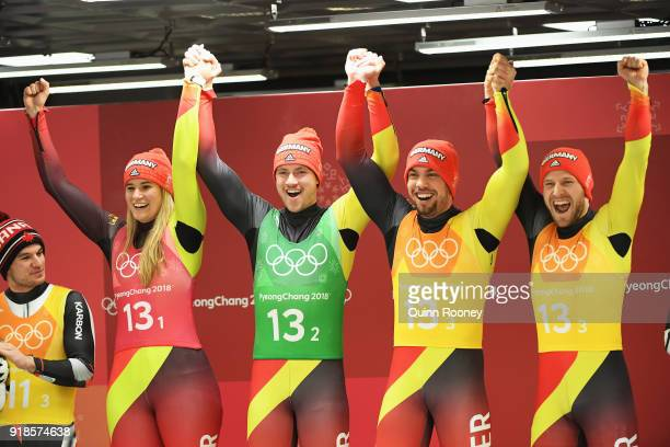 Gold medalists Natalie Geisenberger Johannes Ludwig Tobias Wendl and Tobias Arlt of Germany celebrate on the podium during the victory ceremony after...