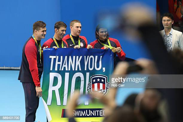 Gold medalists Nathan Adrian Michael Phelps Ryan Murphy and Cody Miller of the United States celebrate during the medal ceremony for the Men's 4 x...