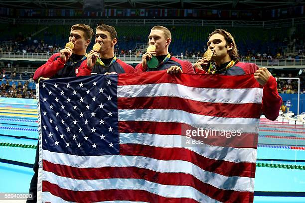 Gold medalists Nathan Adrian Michael Phelps Ryan Murphy and Cody Miller of the United States pose during the medal ceremony for the Men's 4 x 100m...