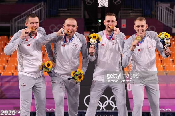 Gold medalists Nauris Miezis, Karlis Lasmanis, Edgars Krumins and Agnis Cavars of Team Latvia pose with their gold medals for the 3x3 Basketball...