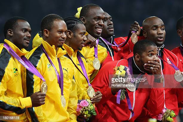 Gold medalists Nesta Carter, Michael Frater, Usain Bolt and Yohan Blake of Jamaica and bronze medalists Keston Bledman, Marc Burns, Emmanuel...
