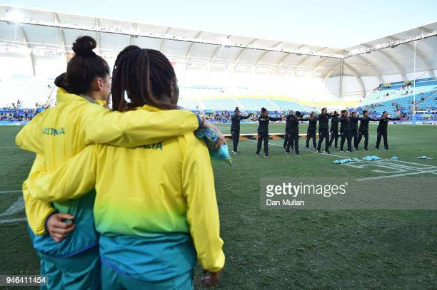 Gold medalists New Zealand perform a Haka as Australia look on during the medal ceremony for the Women's Gold Medal Rugby Sevens Match between...