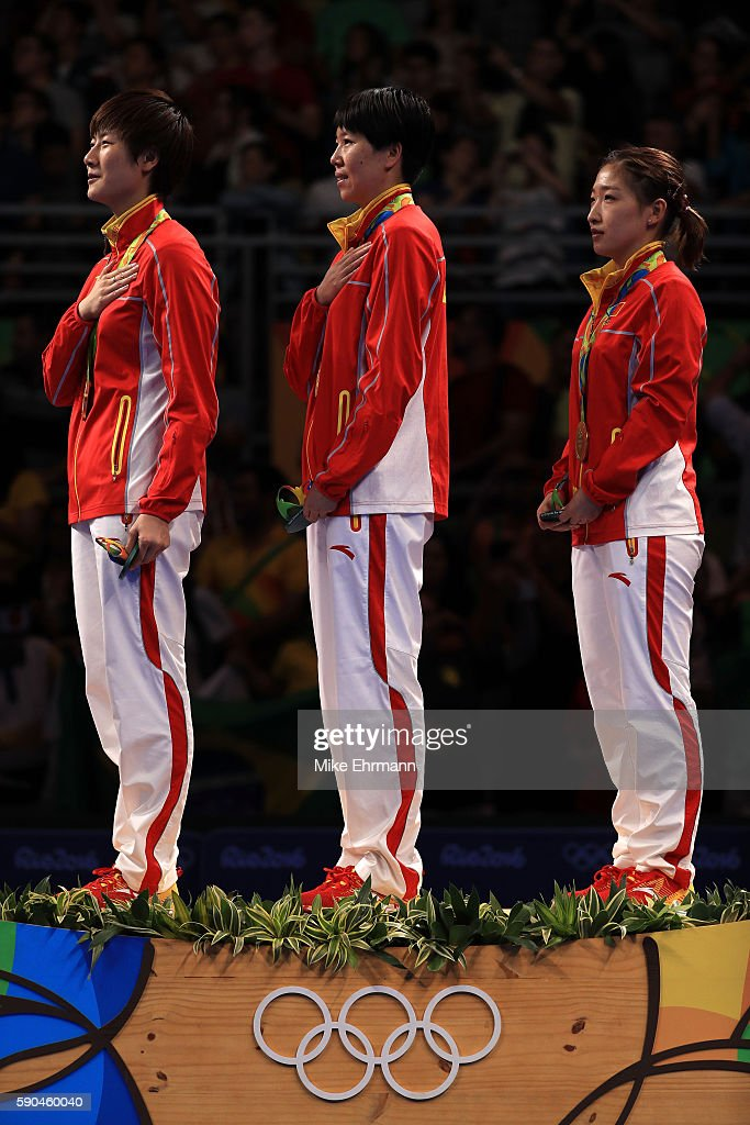 Gold medalists Ning Ding, Xiaoxia Li and Shiwen Liu of China pose on the podium during the medal ceremony for the Women's Team Match between China and Germany on Day 11 of the Rio 2016 Olympic Games at Riocentro - Pavilion 3 on August 16, 2016 in Rio de Janeiro, Brazil.