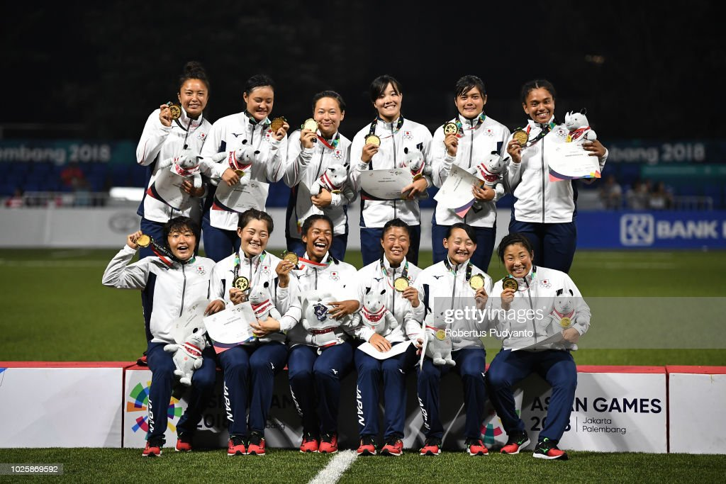 Gold medalists of Japan celebrate on the podium during Women's Rugby Sevens victory ceremony on day fourteen of the Asian Games on September 1, 2018 in Jakarta, Indonesia.