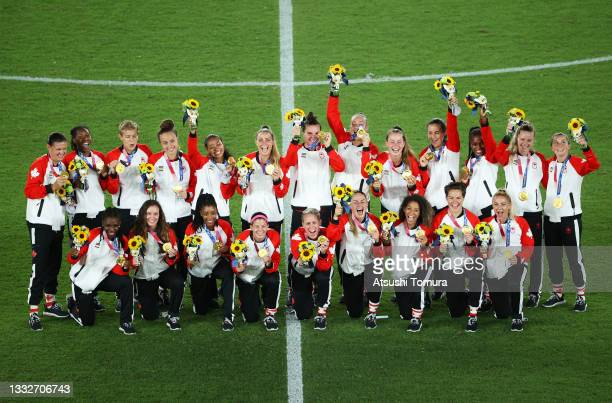 Gold Medalists of Team Canada pose with their gold medals during the Women's Football Competition Medal Ceremony on day fourteen of the Tokyo 2020...